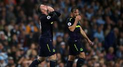 Wayne Rooney, left, celebrates scoring his 200th Premier League goal