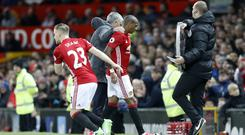 Luke Shaw, left, and Ashley Young, right, are closing in on first-team returns
