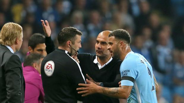 Kyle Walker (right) was sent off before half-time on his home debut for Manchester City.