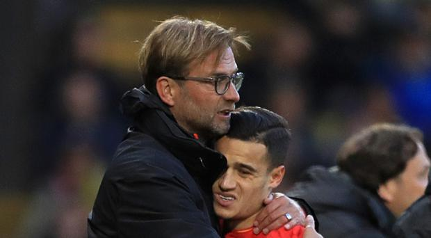 Jurgen Klopp, left, insists everything is fine between him and Philippe Coutinho