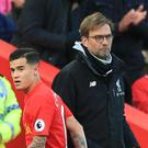 Philippe Coutinho, left, is still unavailable to Jurgen Klopp