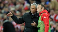 Jose Mourinho, left, understands why Wayne Rooney, right, chose to retire from international football