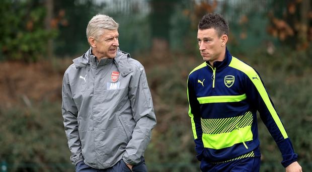 Arsenal manager Arsene Wenger (left) is expected to recall defender Laurent Koscielny (right) for the trip to Liverpool.