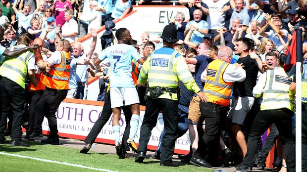 Raheem Sterling celebrates with the crowd after his late winner, earning a second booking