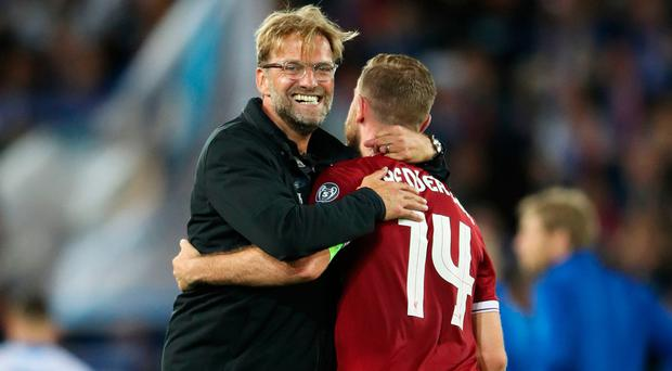 Jurgen Klopp with his skipper Jordan Henderson Photo: PA