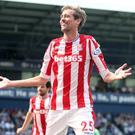 Peter Crouch celebrates Stoke's equaliser at the Hawthorns
