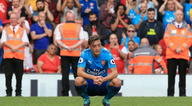Arsenal's Mesut Ozil shows his dejection after the final whistle