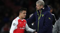 Arsenal boss Arsene Wenger with Alexis Sanchez
