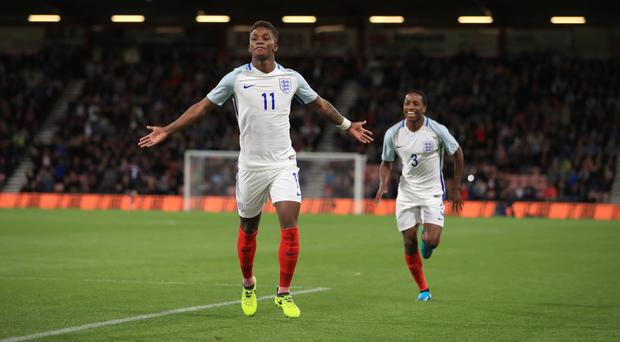 Leicester's Demarai Gray, pictured left, scored England Under-21s' opening goal