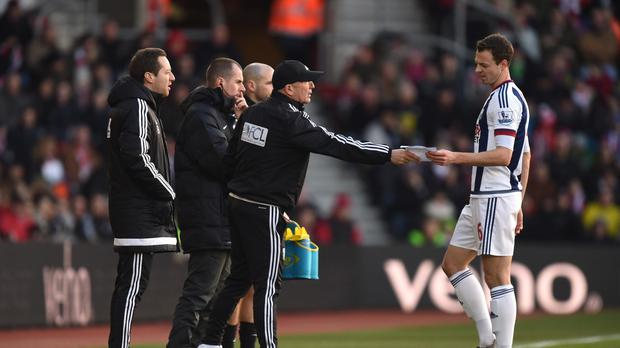 Tony Pulis is happy Jonny Evans (right) stayed at West Brom