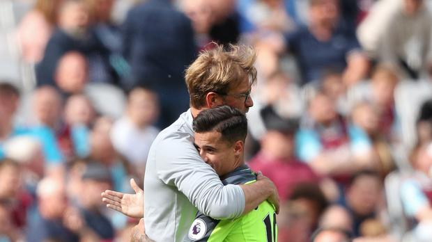 Jurgen Klopp, left, says Philippe Coutinho will not be in the Liverpool squad for the game against Manchester City