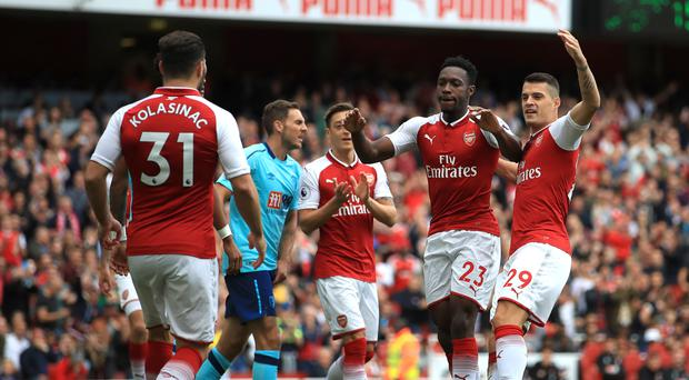Danny Welbeck, second right, scored twice for Arsenal