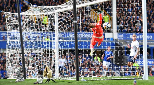 Jordan Pickford is caught out by Harry Kane's cross-shot for the opening goal