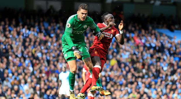 Sadio Mane, right, was shown a red card after colliding with Manchester City's Ederson in Liverpool's 5-0 deafeat