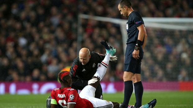 Paul Pogba was injured in Manchester United's Champions League return