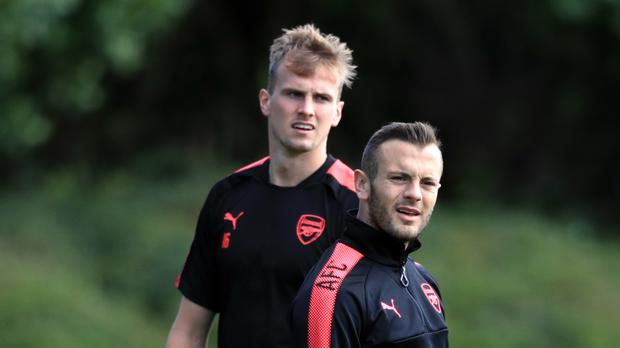 Jack Wilshere, right, is set to play in his first Arsenal match in over a year