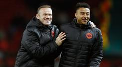 Jesse Lingard, pictured right, is looking forward to reuniting with Wayne Rooney, left