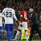 Manchester United's Paul Pogba limps off with a hamstring injury against Basle