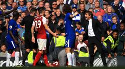 Antonio Conte, right, shows his frustration towards Michael Oliver