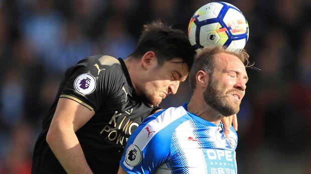 Laurent Depoitre, right, proved a handful for Leicester's Harry Maguire, left