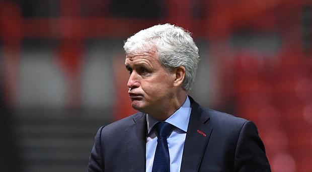 Mark Hughes' Stoke will be without a host of defenders on Saturday