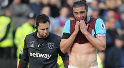 Andy Carroll, ight, has been plagued by injuries since joining West Ham