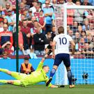 Tottenham striker Harry Kane, right, continued his fine form against West Ham