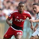 Watford's Andre Carrillo (left) and Swansea City's Roque Mesa battle during the Hornets' 2-1 Premier League win at the Liberty Stadium.