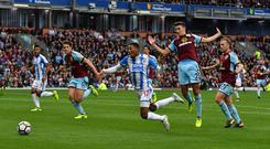 Rajiv van La Parra, centre, saw his dive against Burnley condemned by both managers after Huddersfield's 0-0 draw at Turf Moor