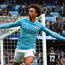 Leroy Sane celebrates after scoring Manchester City's first goal yesterday in the 5-0 win overCrystal Palace,and, right, Jose Mourinho is sent from the line by referee Craig Pawson. Photo: AFP/Getty
