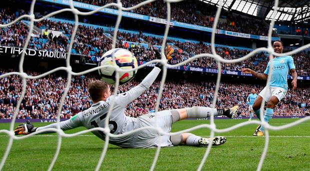 Manchester City's Raheem Sterling scores his side's second goal past Wayne Hennessey. Photo: Getty