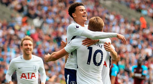 Harry Kane celebrates scoring his side's first goal with team-mate Dele Alli. Photo: Getty