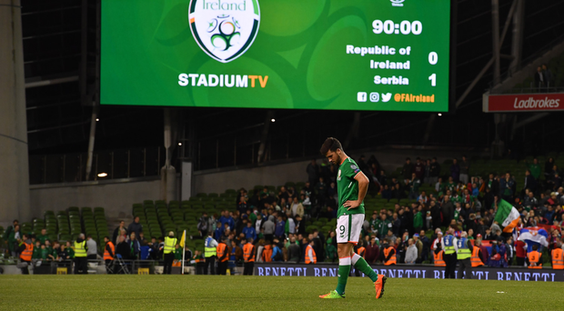 A dejected Shane Long leaves the pitch after the Group D defeat to Serbia. Photo: Brendan Moran