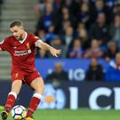 Liverpool's Jordan Henderson scores in their 3-2 win over Leicester on Saturday.