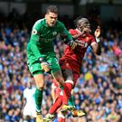 Manchester City goalkeeper Ederson was injured in a clash with Liverpool's Sadio Mane