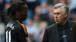 Didier Drogba, left, helped Carlo Ancelotti's Chelsea rack up a record Premier League goal tally