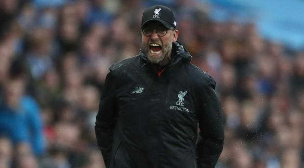 Liverpool manager Jurgen Klopp is unhappy about proposals to reschedule their Premier League match at Arsenal for Christmas Eve.