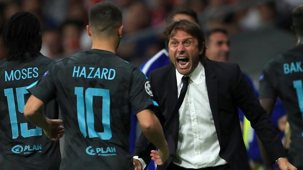 Chelsea's manager Antonio Conte, right, celebrates the first goal against Atletico Madrid with Eden Hazard