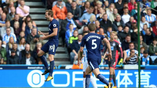 Tottenham Hotspur's Harry Kane celebrates scoring his side's third goal of the game during the Premier League match at the John Smith's Stadium, Huddersfield.