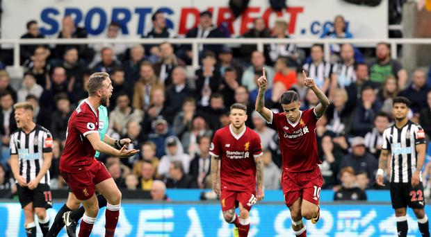 Philippe Coutinho celebrates scoring Liverpool's goal against Newcastle at St James' Park