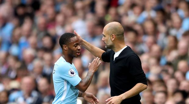 Manchester City boss Pep Guardiola, pictured right, says Raheem Sterling, left, should show England his quality