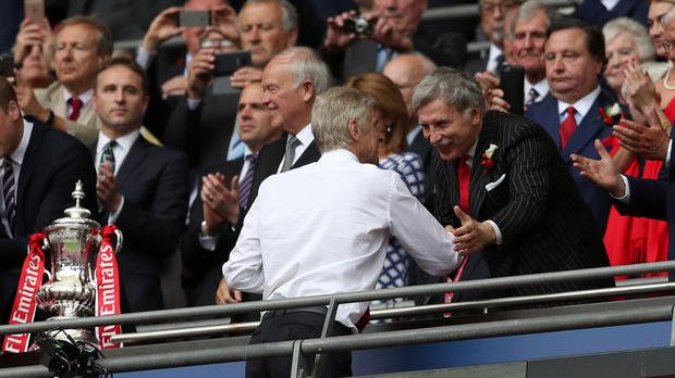 Arsenal majority shareholder Stan Kroenke (right) is said to be ready to offer a £525million buy out of Alisher Usmanov's 30% stake