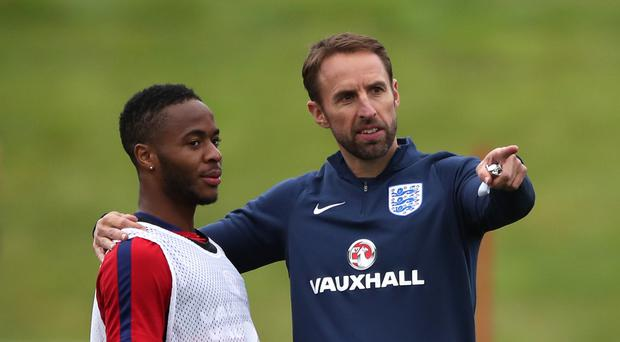 Gareth Southgate, right, believes Raheem Sterling, left, can turn around his England fortunes