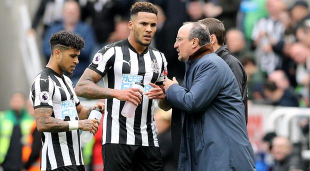Jamaal Lascelles, centre, has signed a new long-term contract with Newcastle