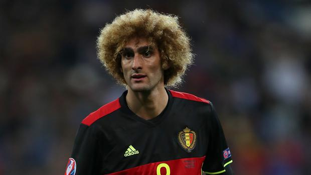 Marouane Fellaini suffered a knee ligament injury in Belgium's win over Bosnia and Herzegovina