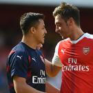 Alexis Sanchez, left, and Mesut Ozil could leave Arsenal for free next summer