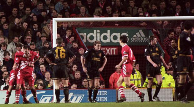 Neil Ruddock of Liverpool (left) celebrates scoring against Manchester United in January 1994