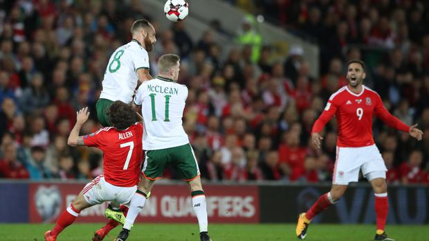 Joe Allen, left, suffers a head injury while playing for Wales on Monday night