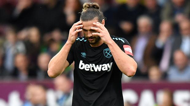 West Ham striker Andy Carroll leaves the field after being sent off for a second booking