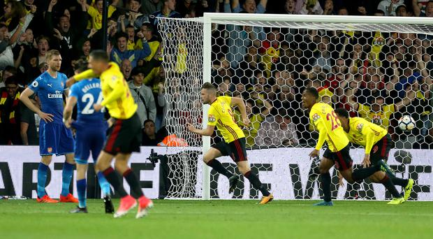 Tom Cleverley wheels away in celebration, pursued by his team-mates after another decisive late goal for Watford